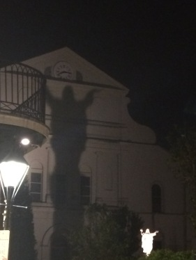 A spooky sight, thanks to a statue behind St. Louis Cathedral