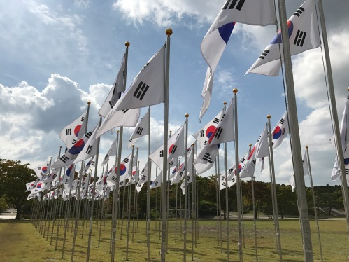 Flags outside of the Grand Hall of the Nation